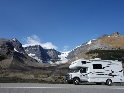 RV driving through the mountains.